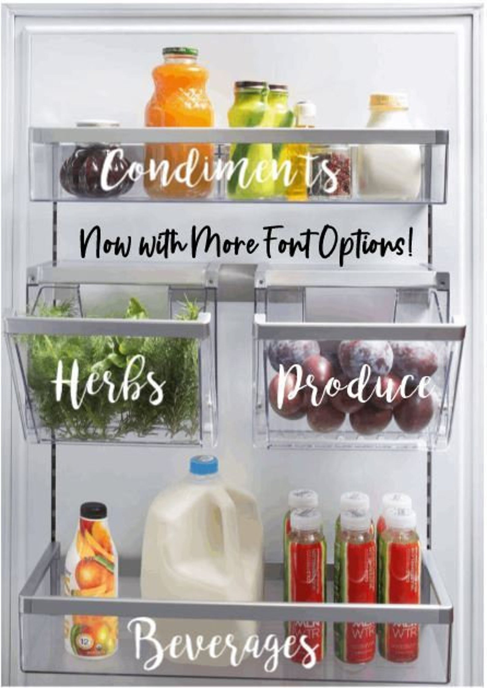 A set of labels in white font on fridge drawers for produce, herbs, etc