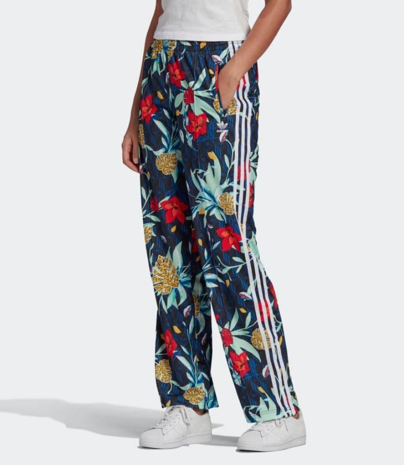 Model wearing floral track pants