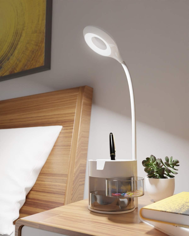 A tall slim desk lamp with an organizer base