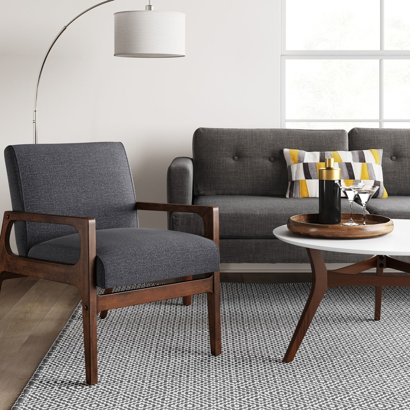 gray armchair with wood frame in a living room next to a gray couch