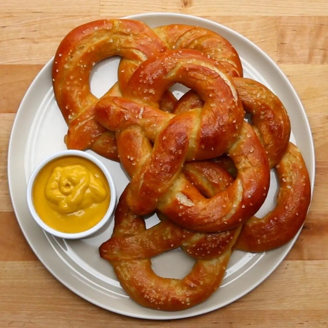 The pretzels on a plate with a side of mustard
