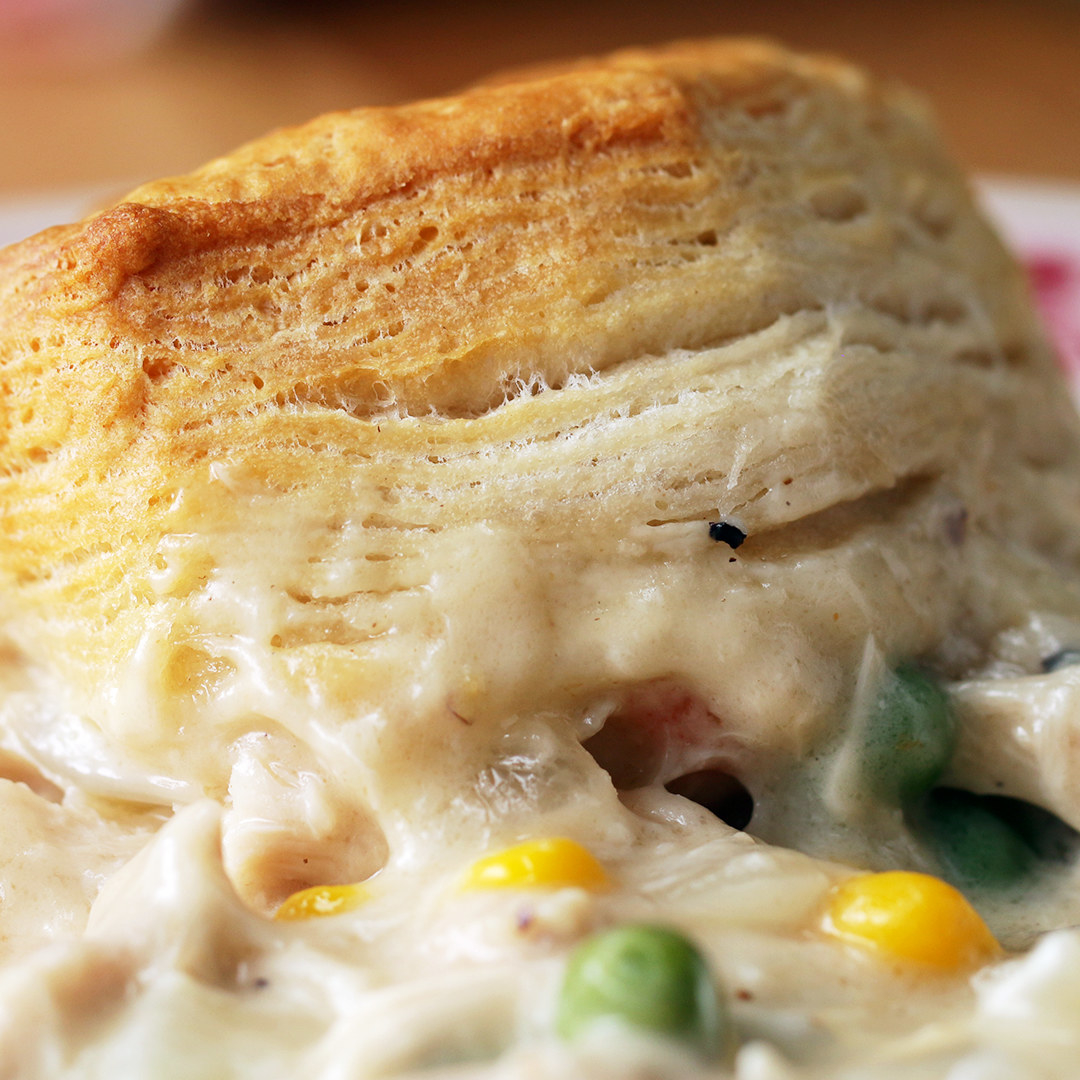A biscuit on top of the creamy chicken filling