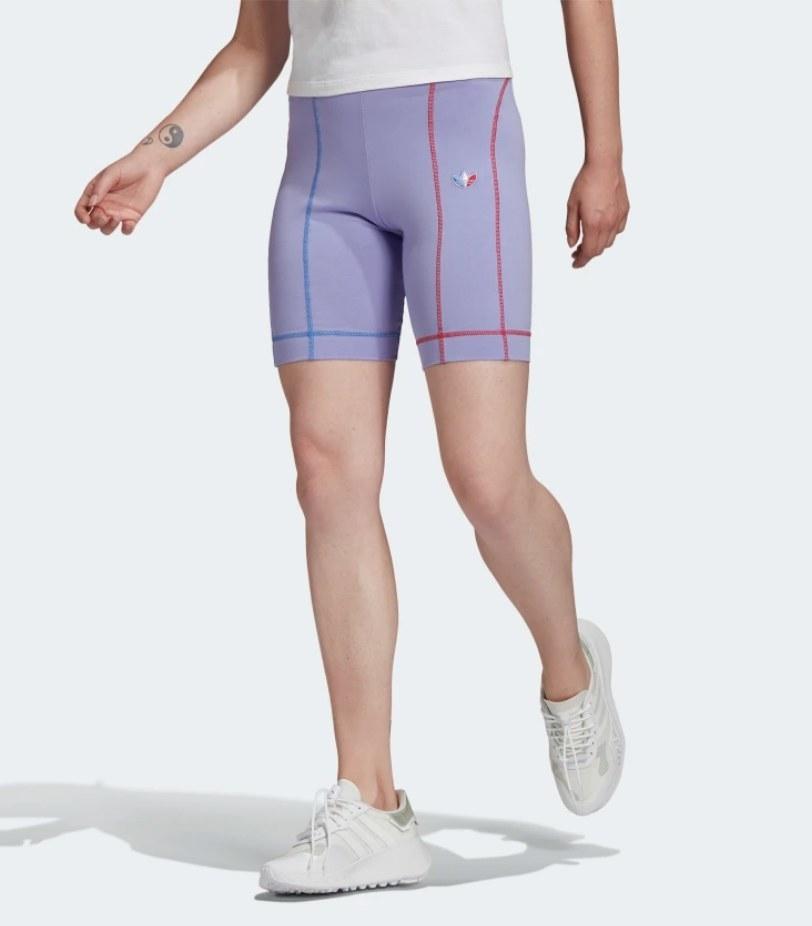 Model wearing purple biker shorts