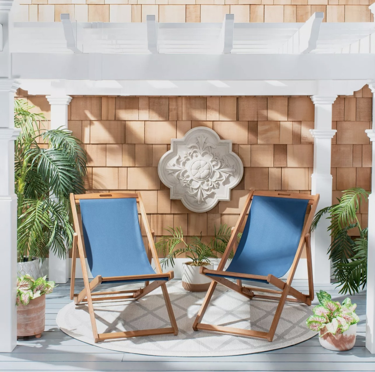 The two blue sling chairs