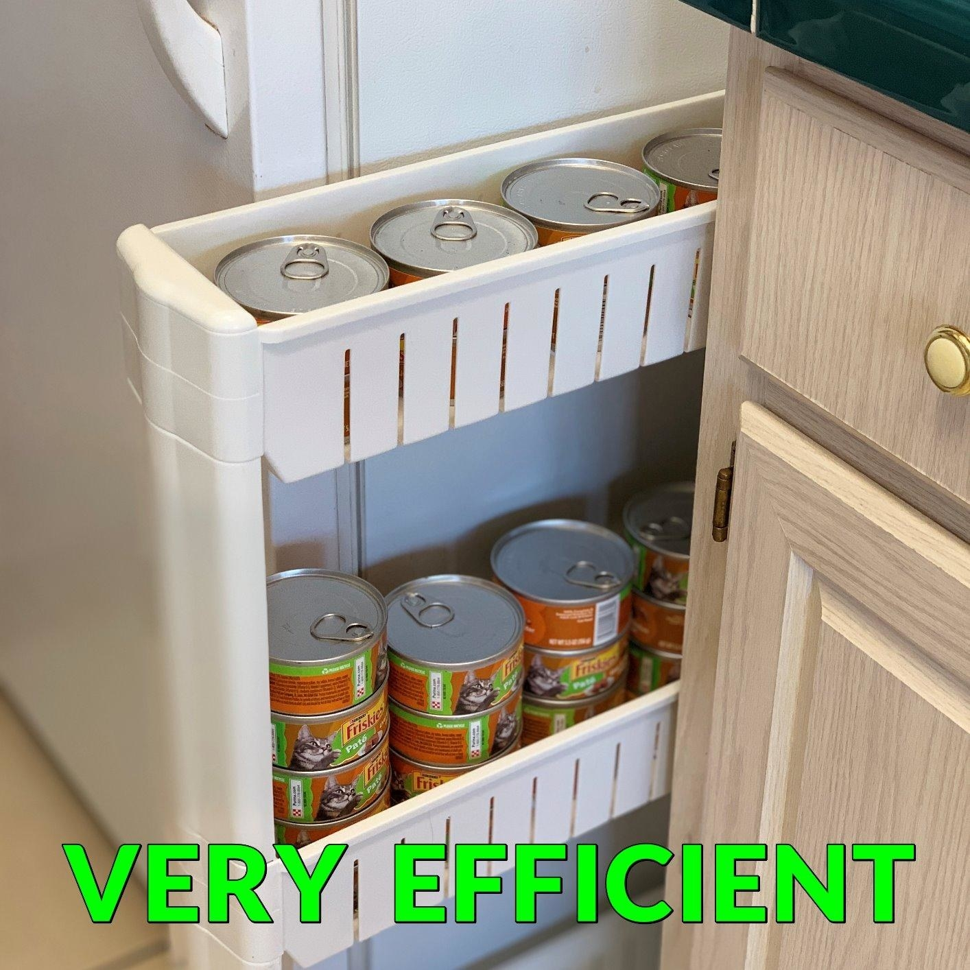 white storage unit holding cans of cat food sliding out from between a fridge and counter, with the text