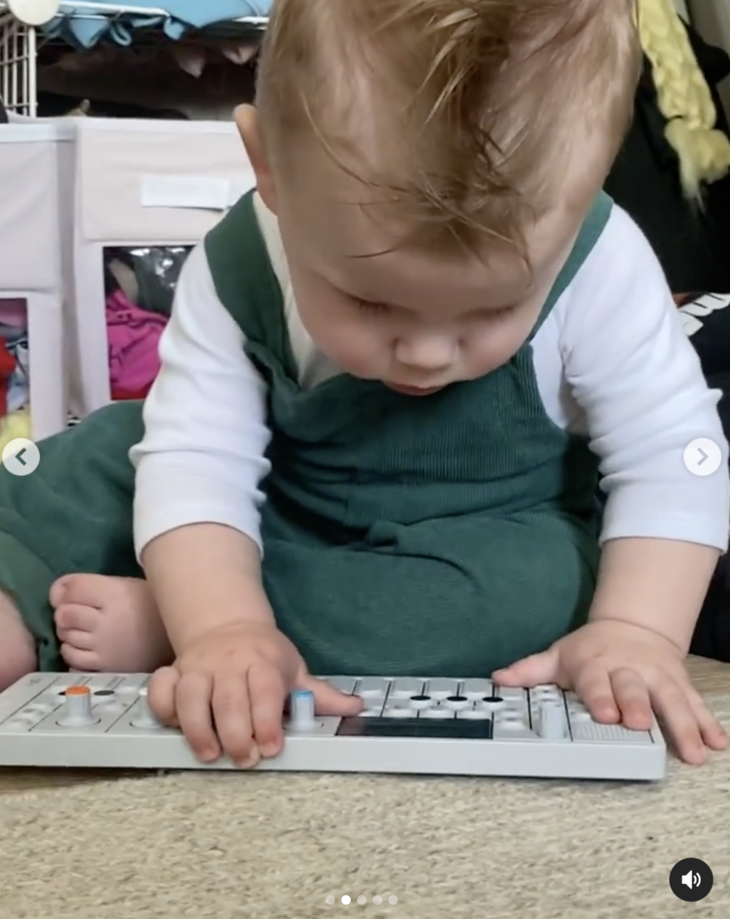 Lil X looking at the keyboard