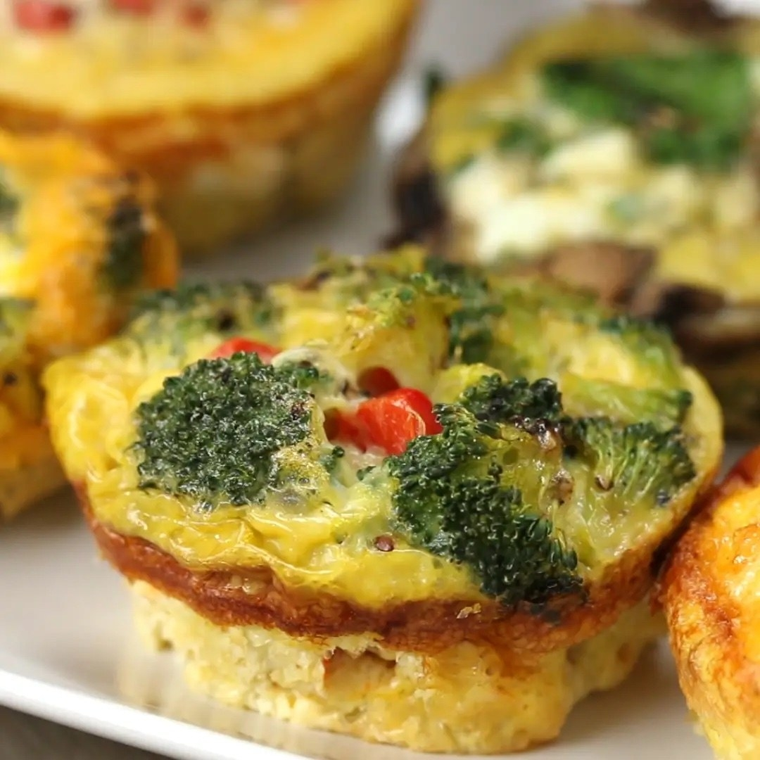 An egg cup with broccoli and peppers