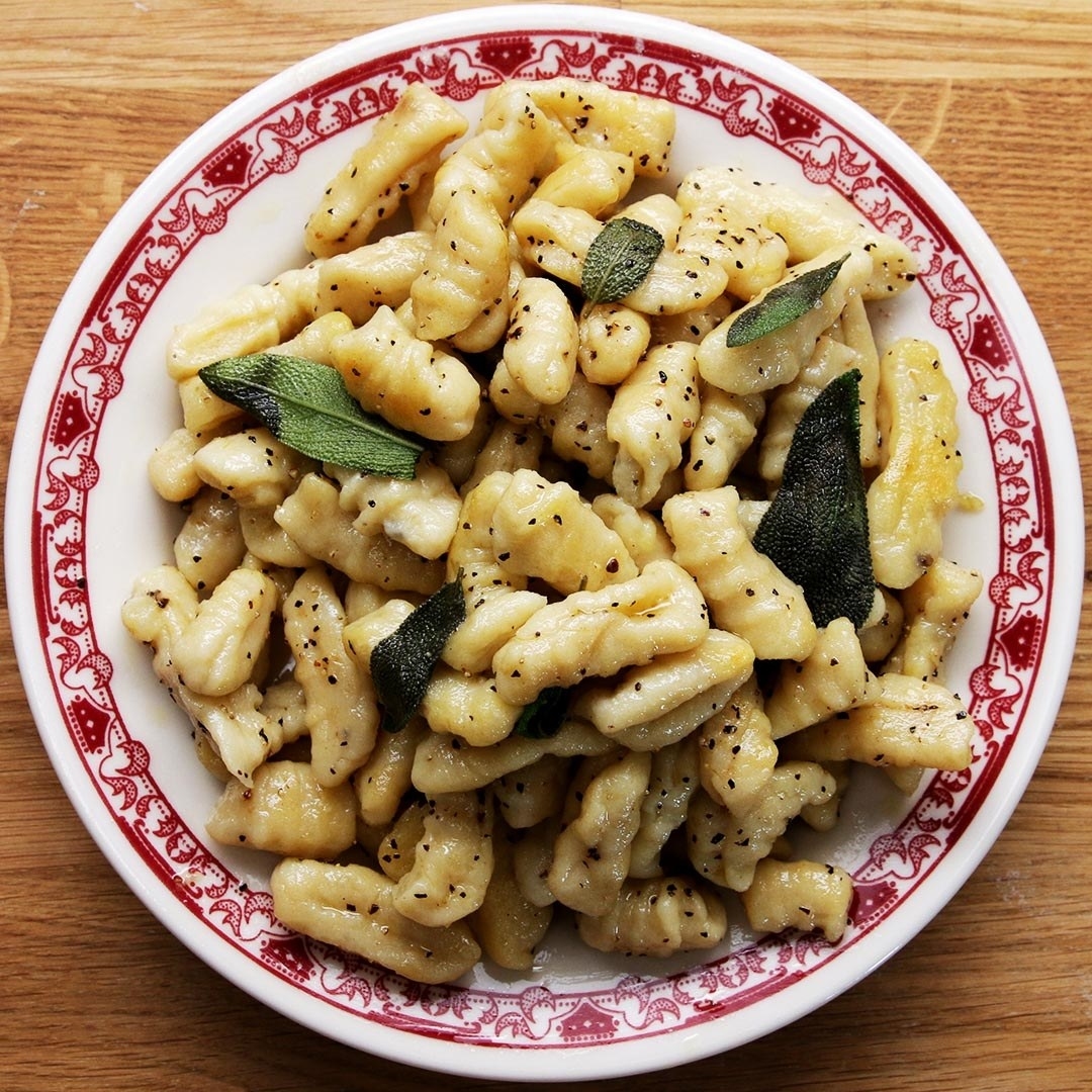 The gnocchi and sage on a patterned plate