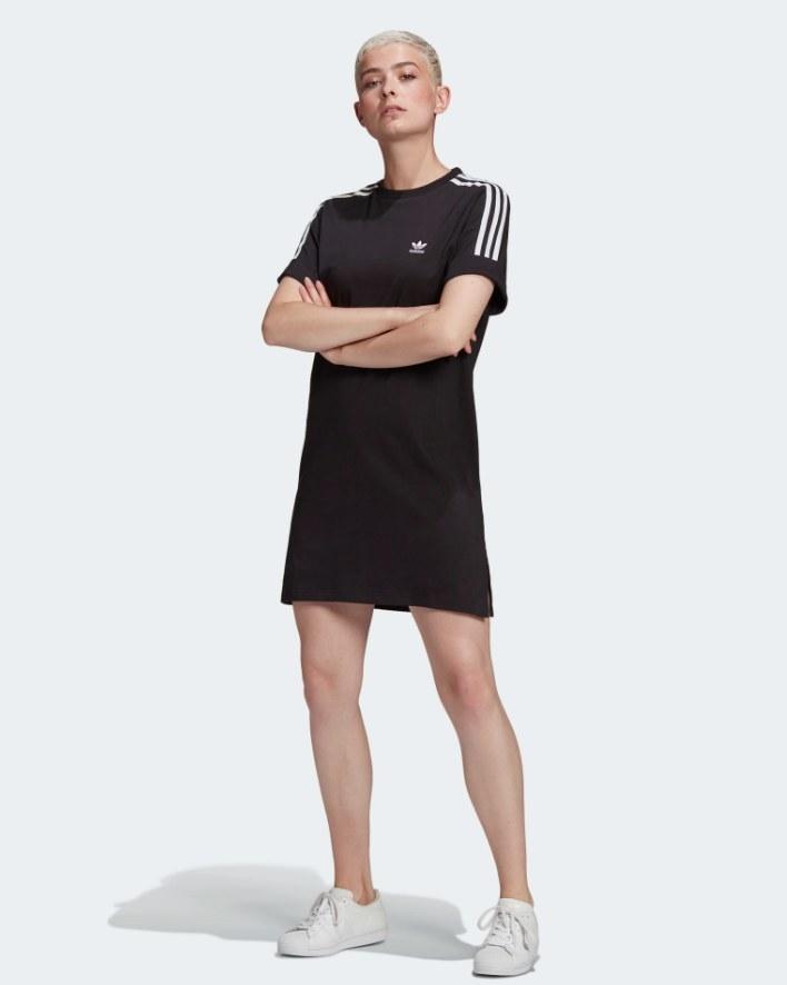 Model wearing black t shirt dress