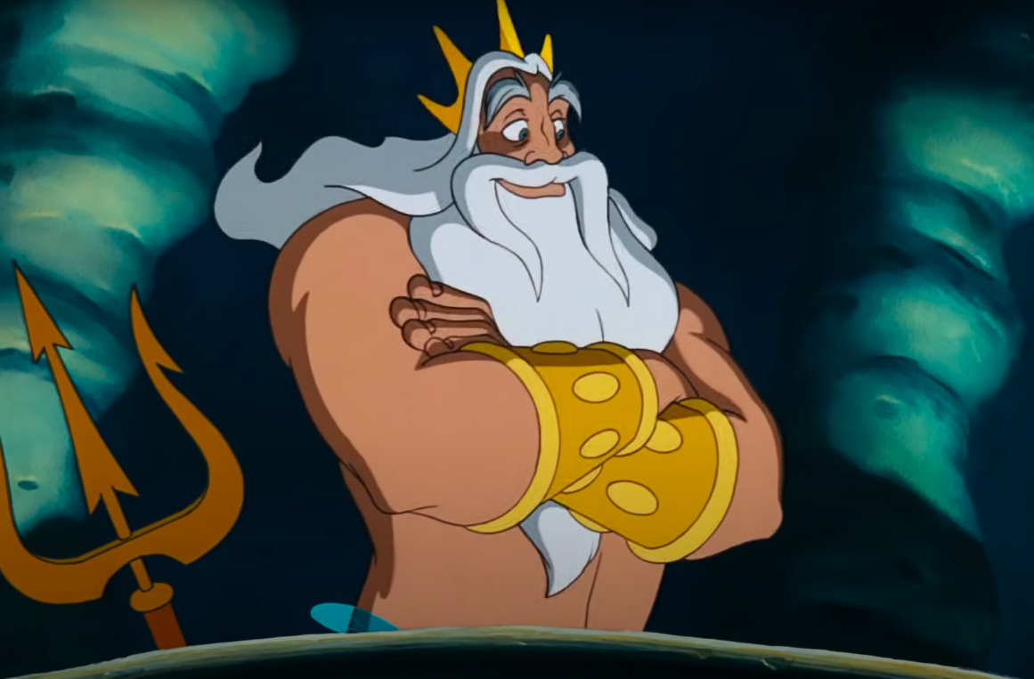 King Triton smiling with his arms crossed