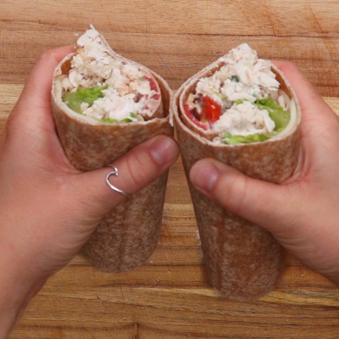 Hands holding the two halves of the wrap