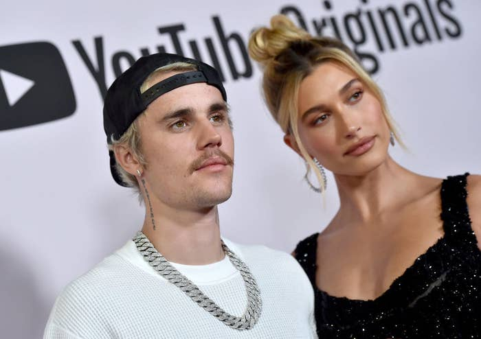 Hailey and Justin posing on a red carpet