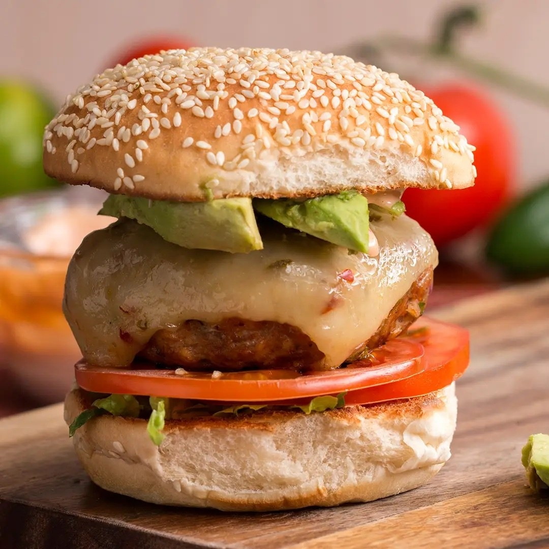 The tall burger with avocado and tomatoes