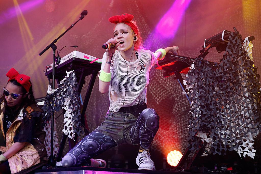 Grimes performing onstage