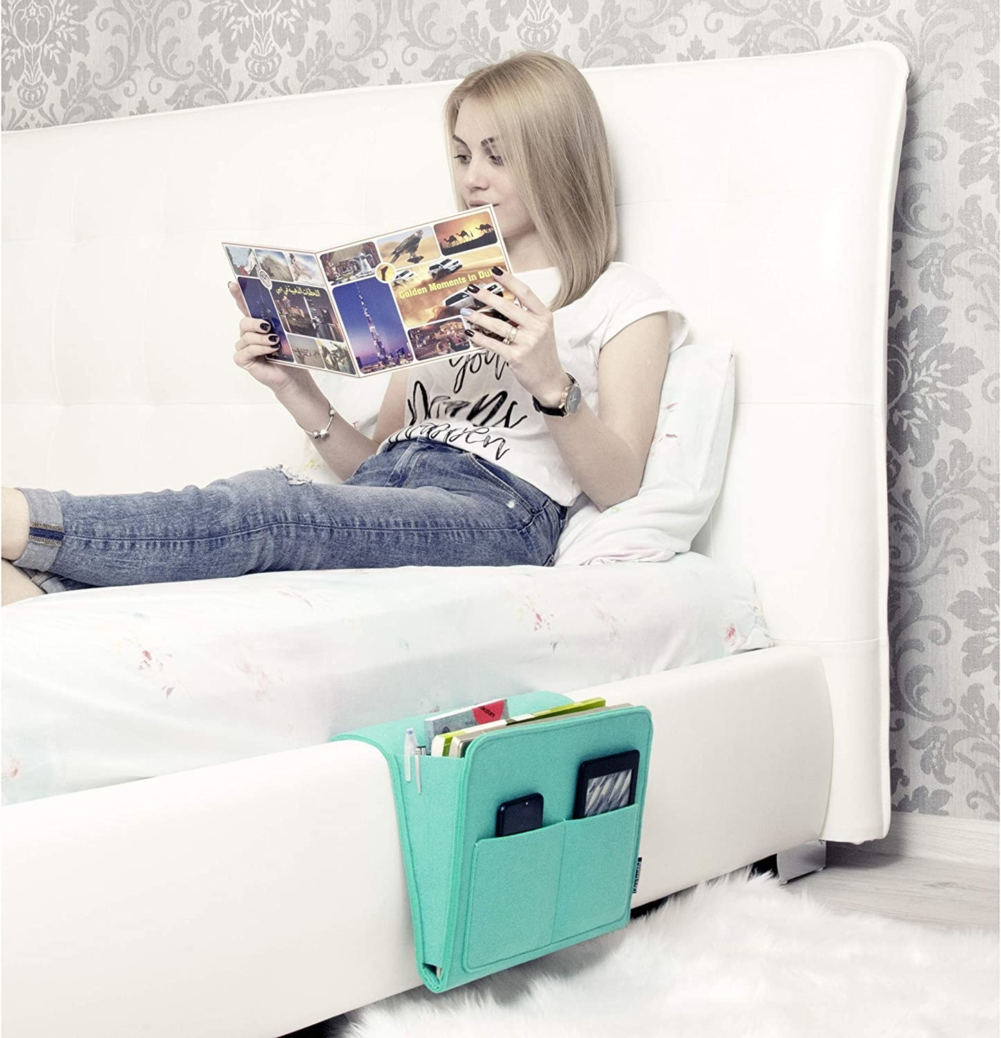 model lounges on bed with green bedside caddy on the side