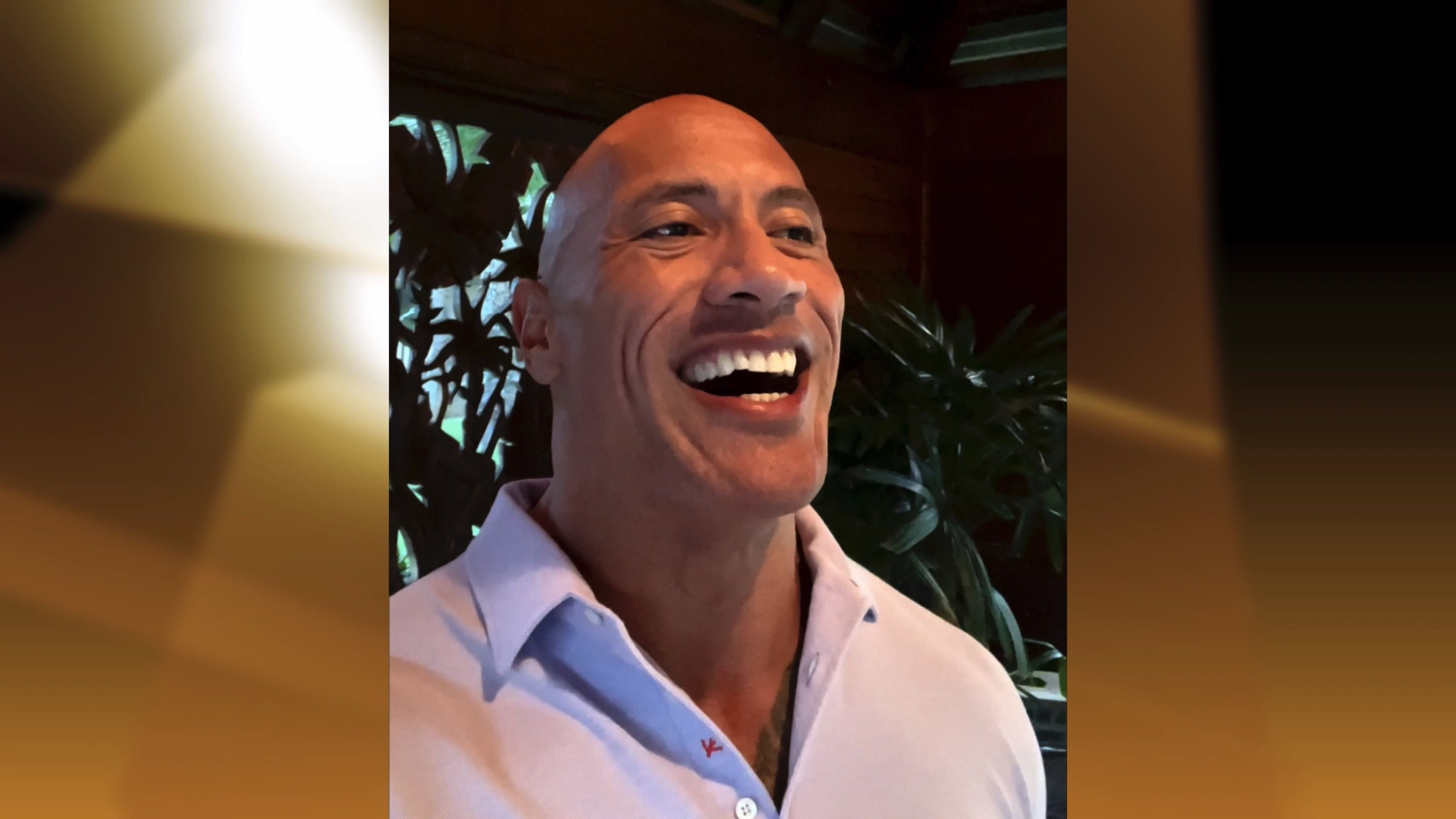 The Rock smiling widely