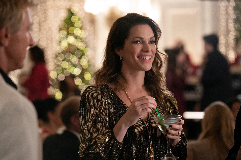 Amanda holding a martini in Cobra Kai