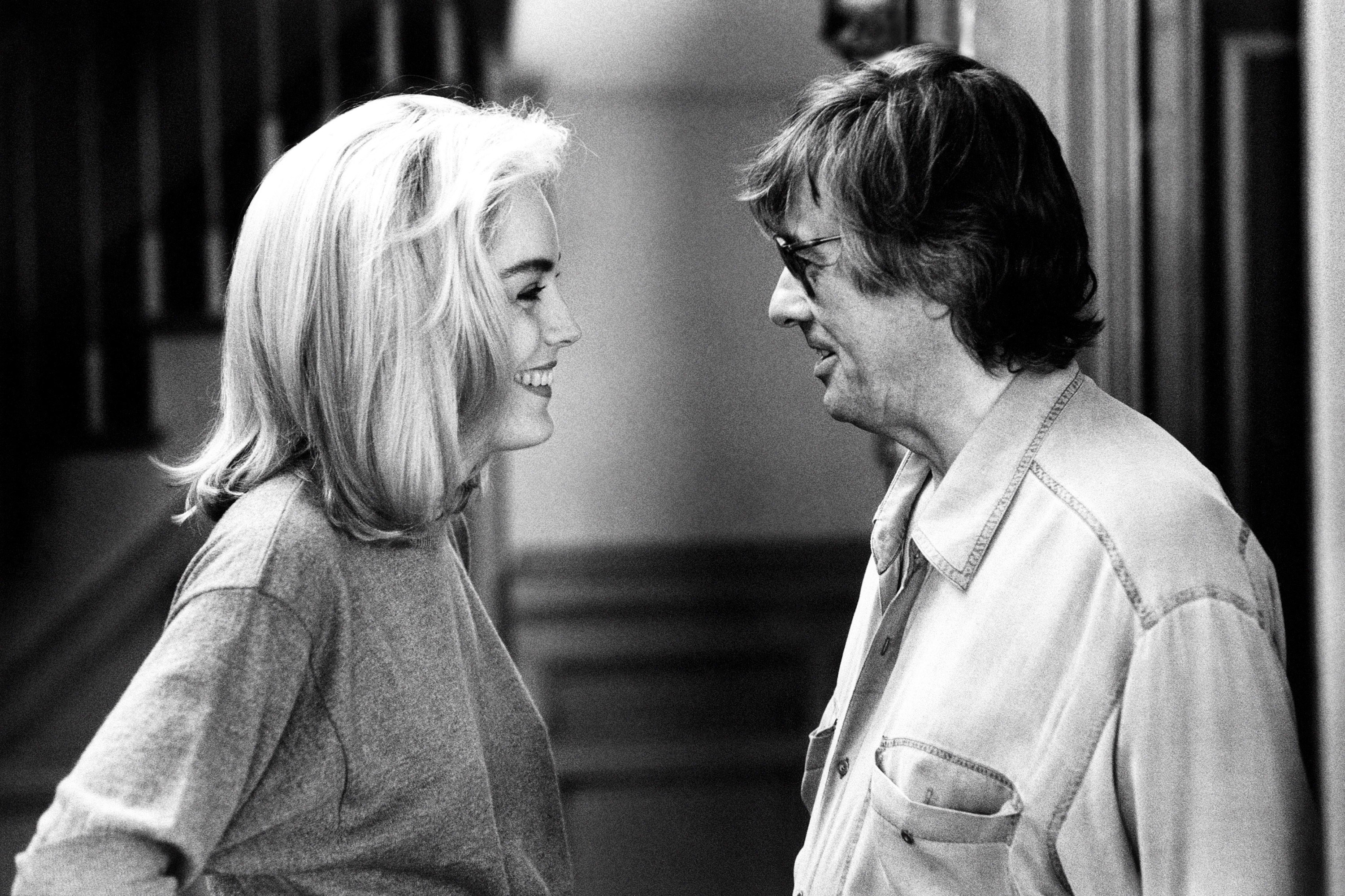 Stone and Paul Verhoeven on the set of Basic Instinct