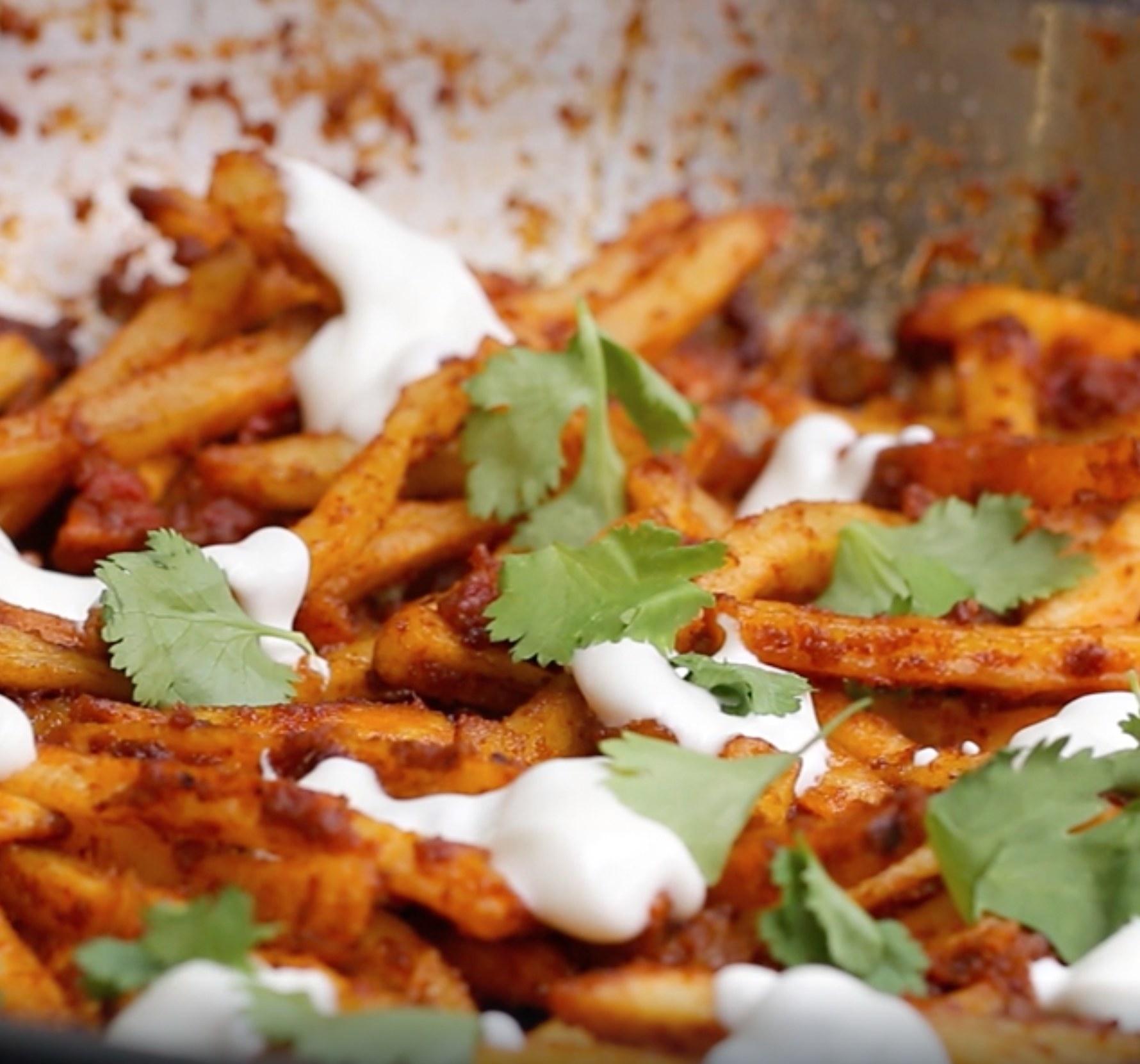 Masala french fries with yogurt and fresh coriander
