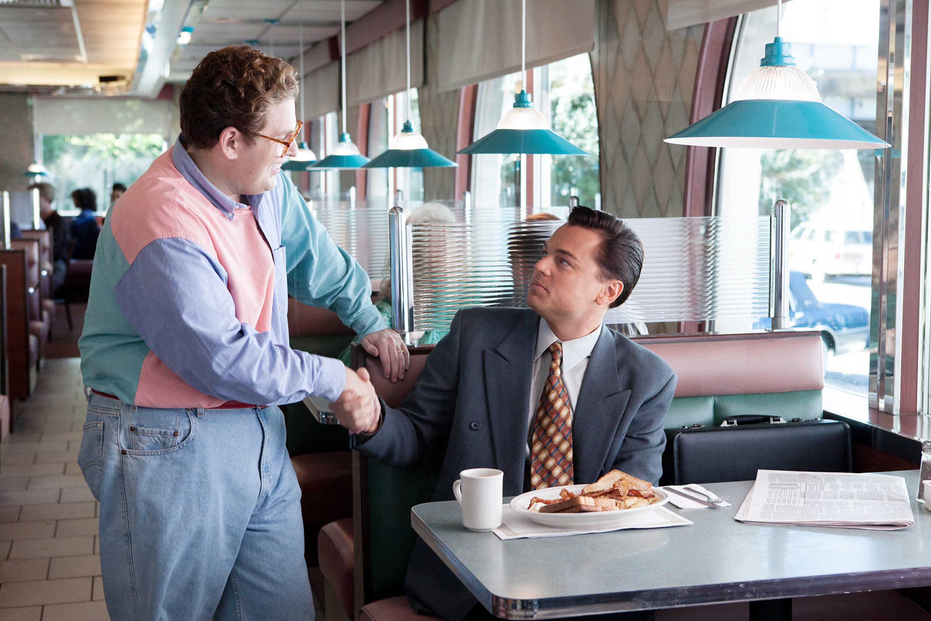 Jonah shaking Leo's hand in the film at a diner