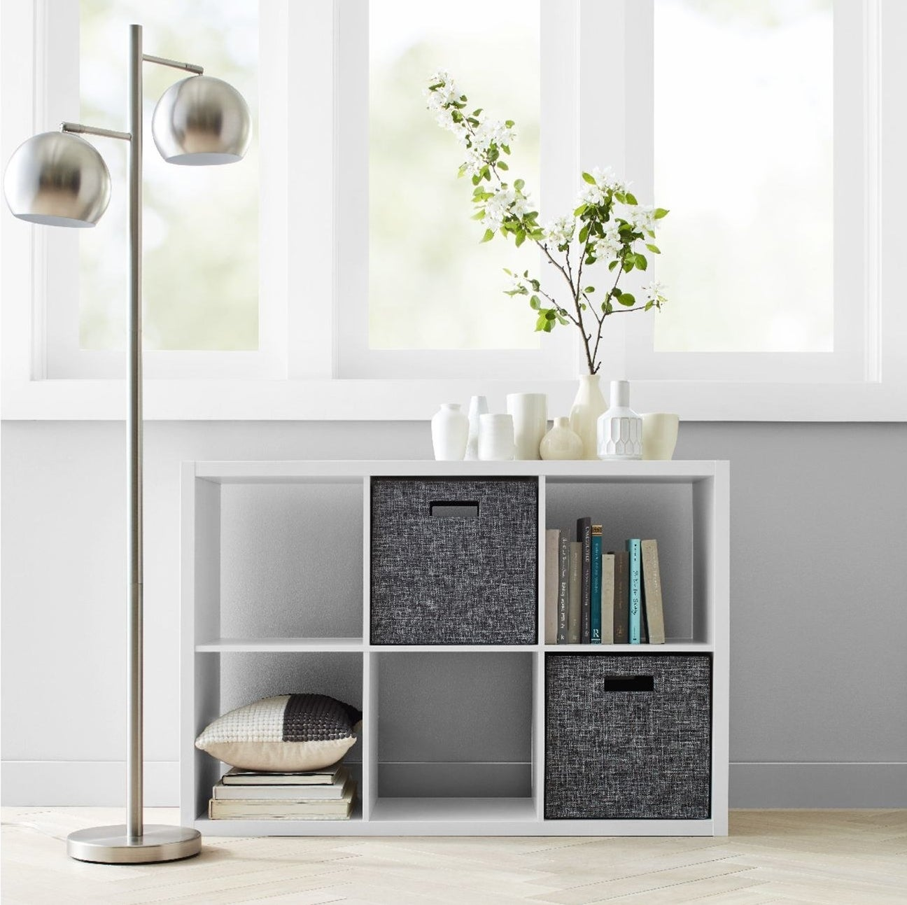 white six cube organizer shelf with books and grey cubes inside