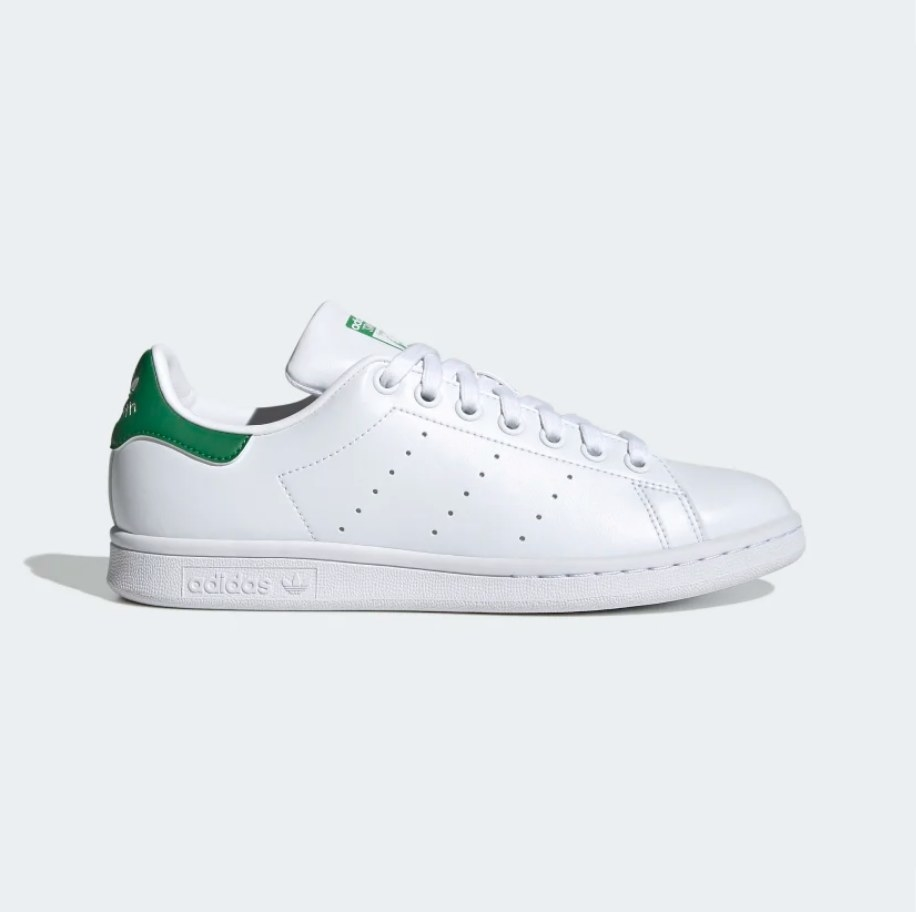 White Sam Smith sneaker with green detailing