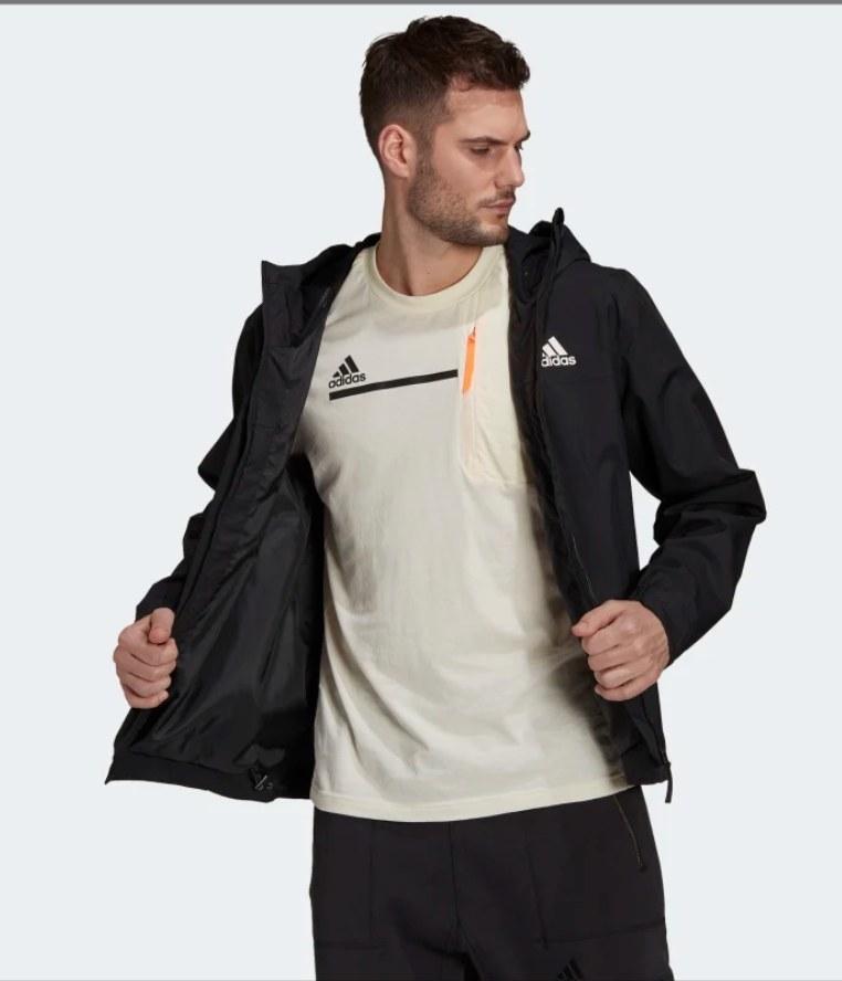 Model wearing black rain jacket