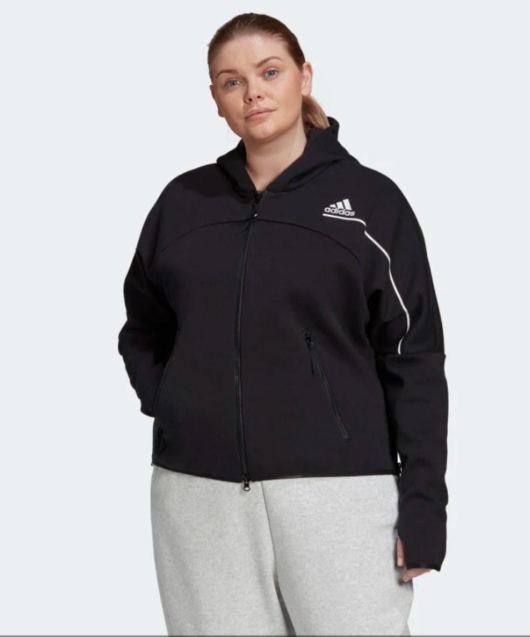 Model wearing black zip up hoodie