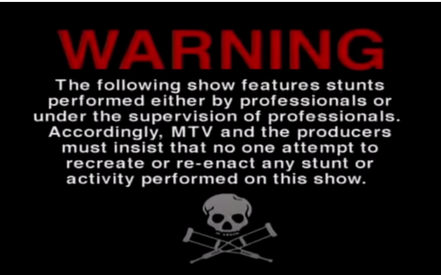 The warning logo for Jackass featuring a skull with crutches as cross bones