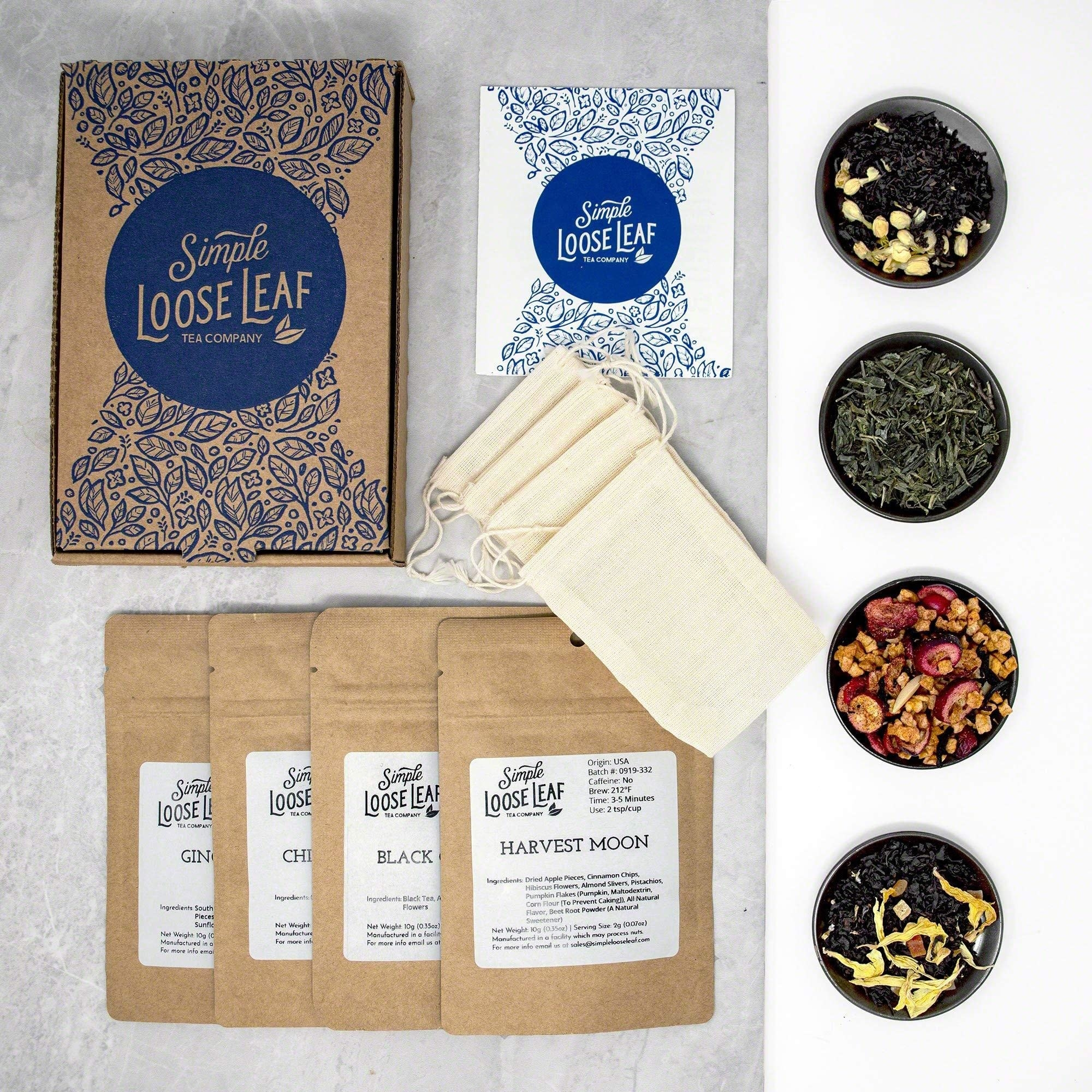 the subscription box with all its contents, including four teas, the packages, the pouches, the notecard and the box