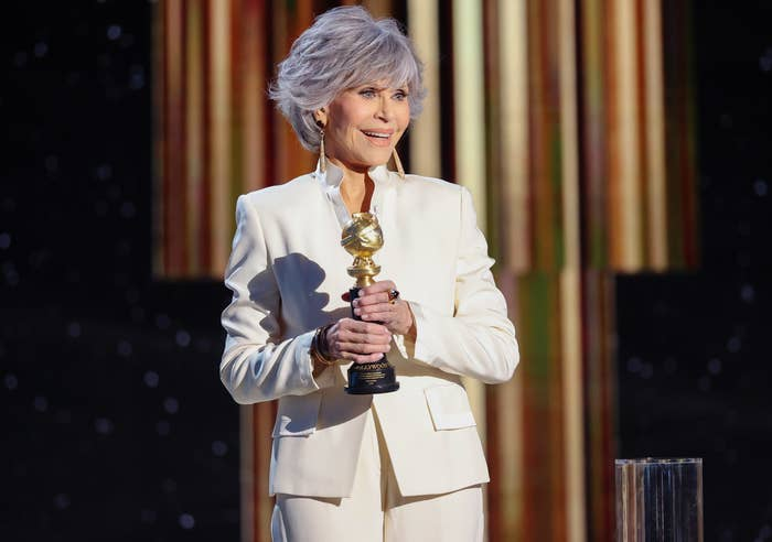 Jane holds her award while speaking