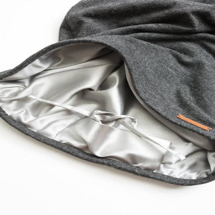 Satin lined cap on white background