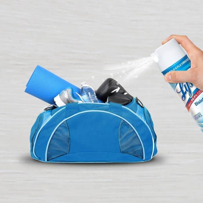 A can of lysol spraying a gym bag
