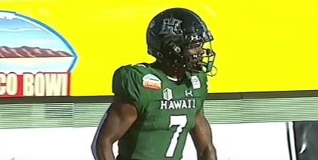 "Black helmet with a dark green ""H"""