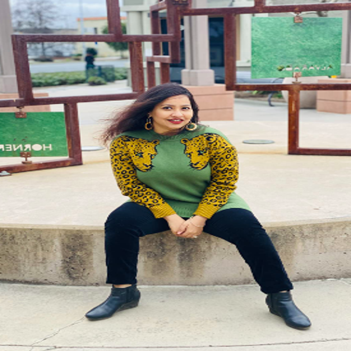 Different reviewer wearing the sweater in green and yellow