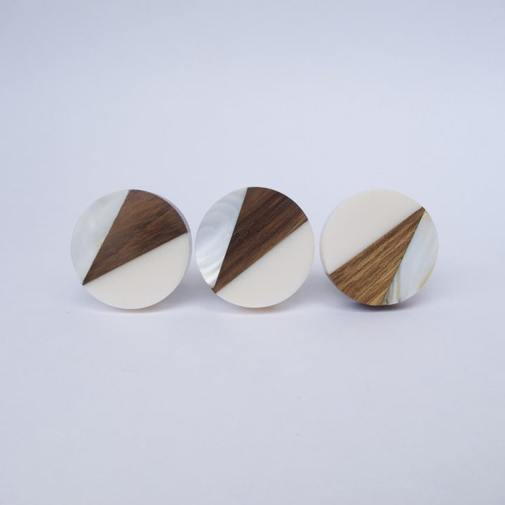 circular flat knobs with triangle geometric design with wood, silver, and mother of pearl