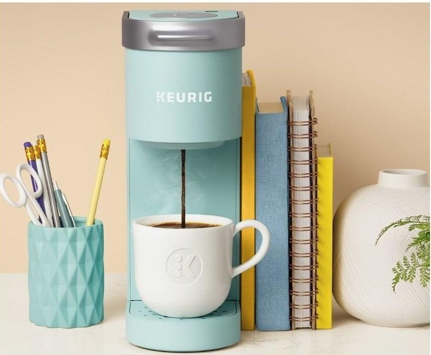 A blue single-serve coffee maker