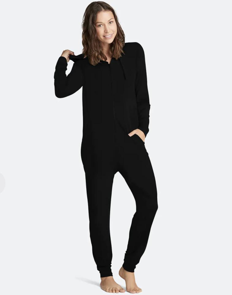 model wearing black onesie
