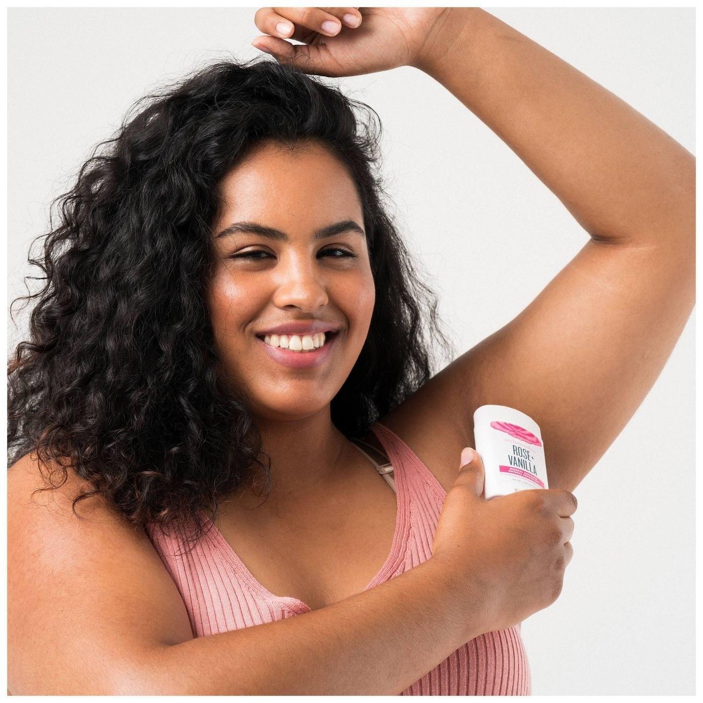 Model applying deodorant