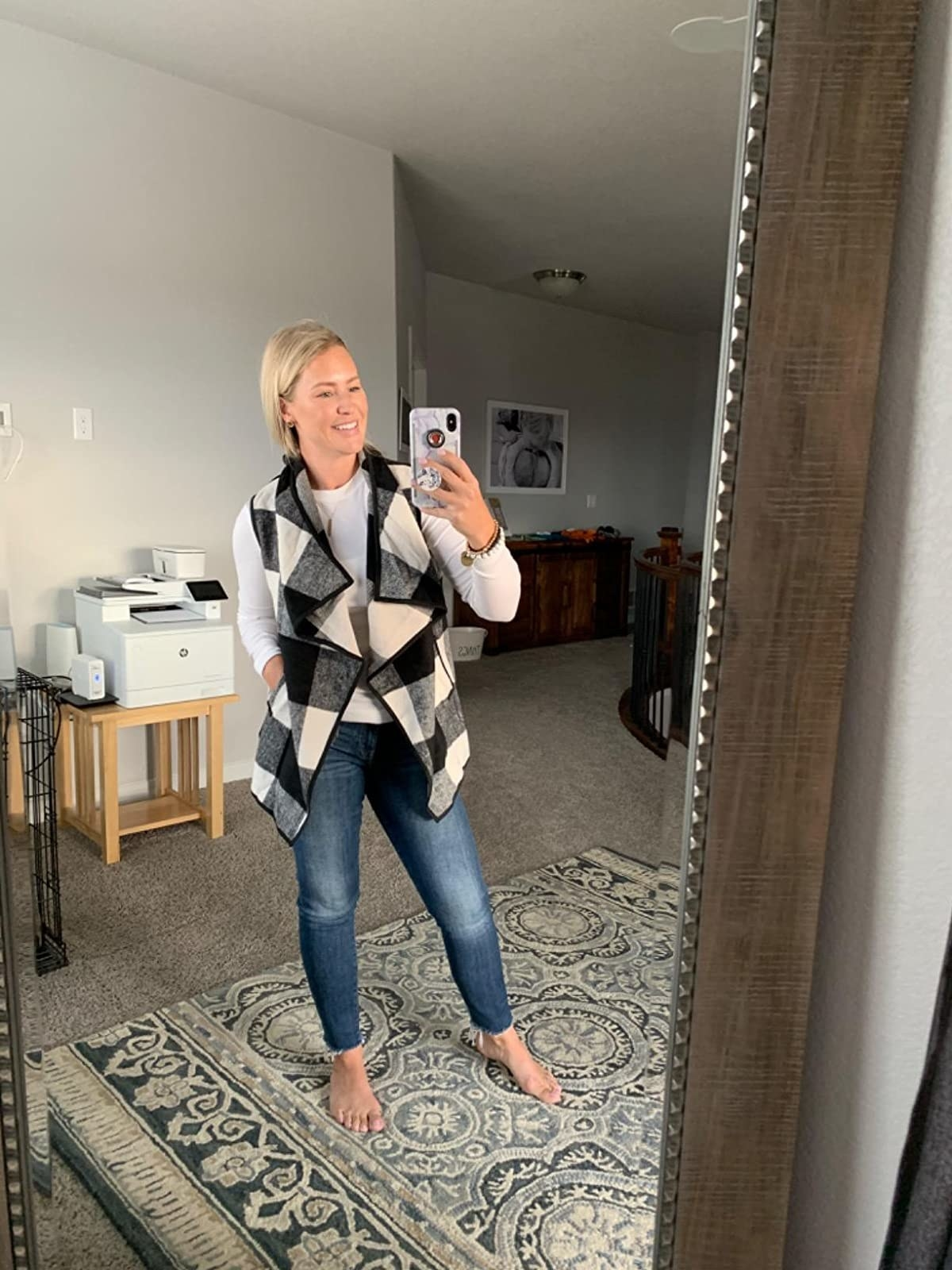 reviewer wearing vest with long sleeve shirt