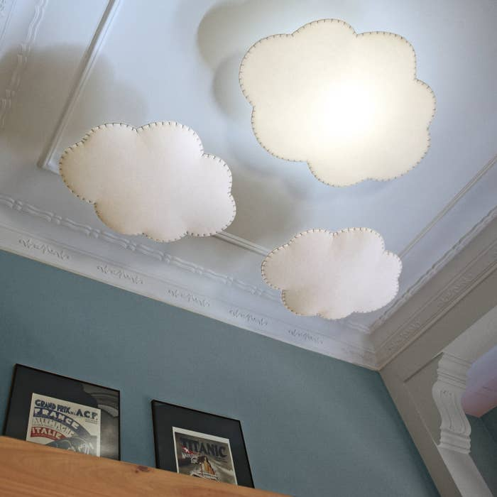 three cloud lamps hanging from a ceiling