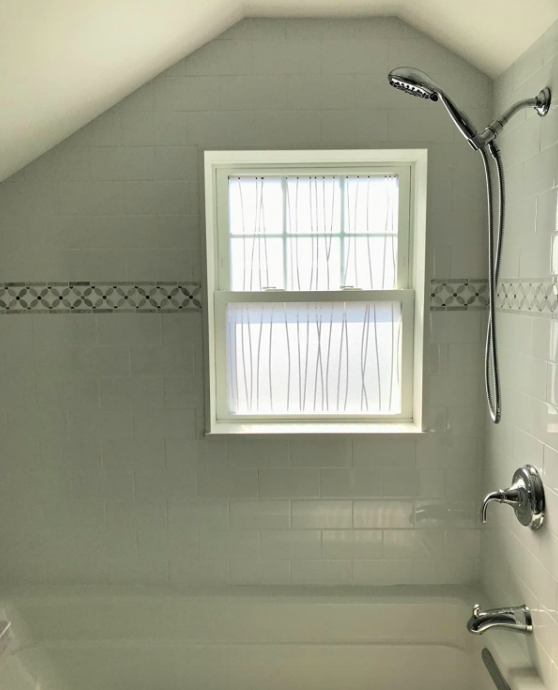 A customer review photo of their bathroom window with the film installed
