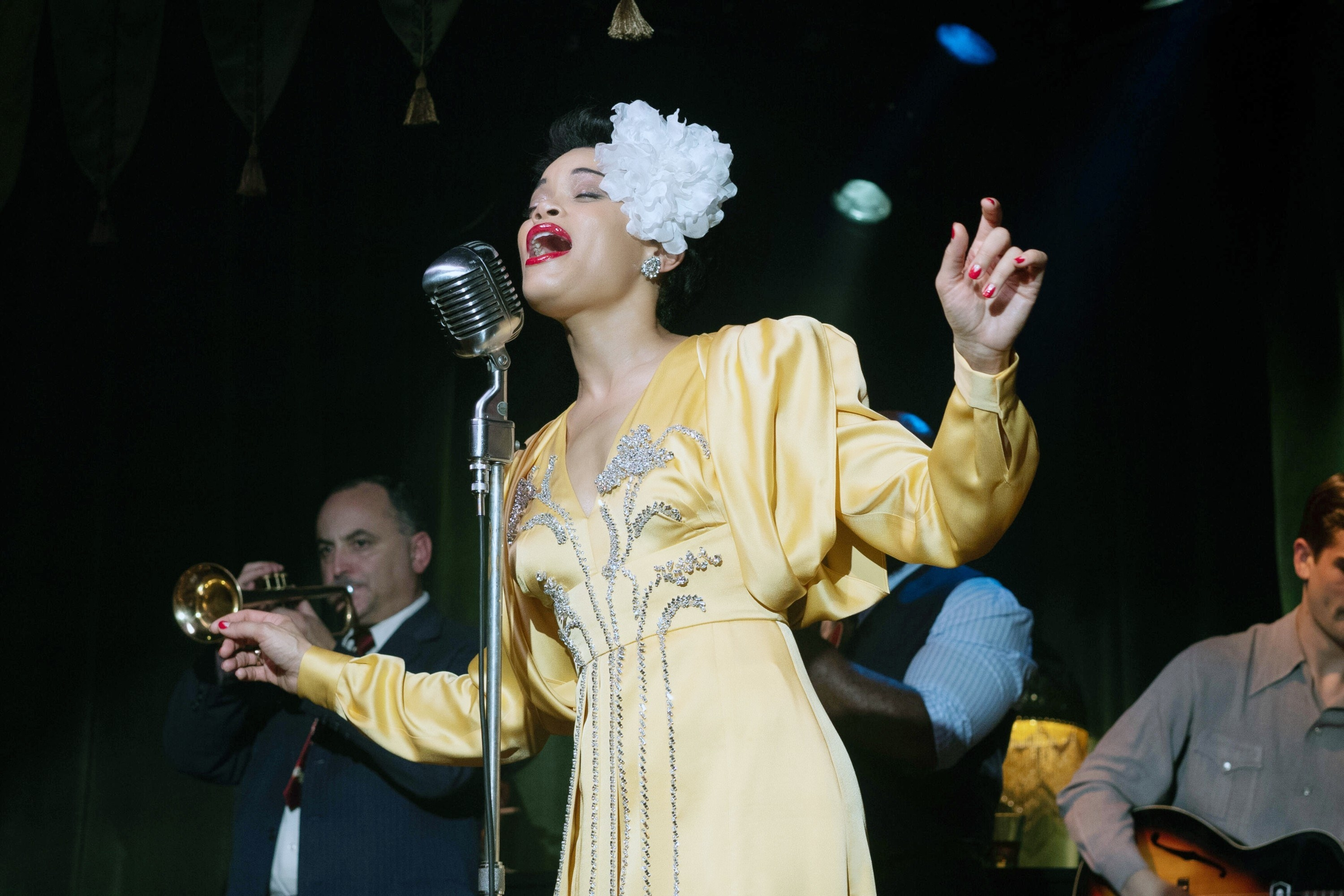 Andra performing on stage as Billie Holiday