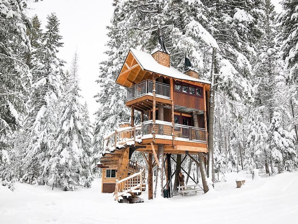 the treehouse covered in snow