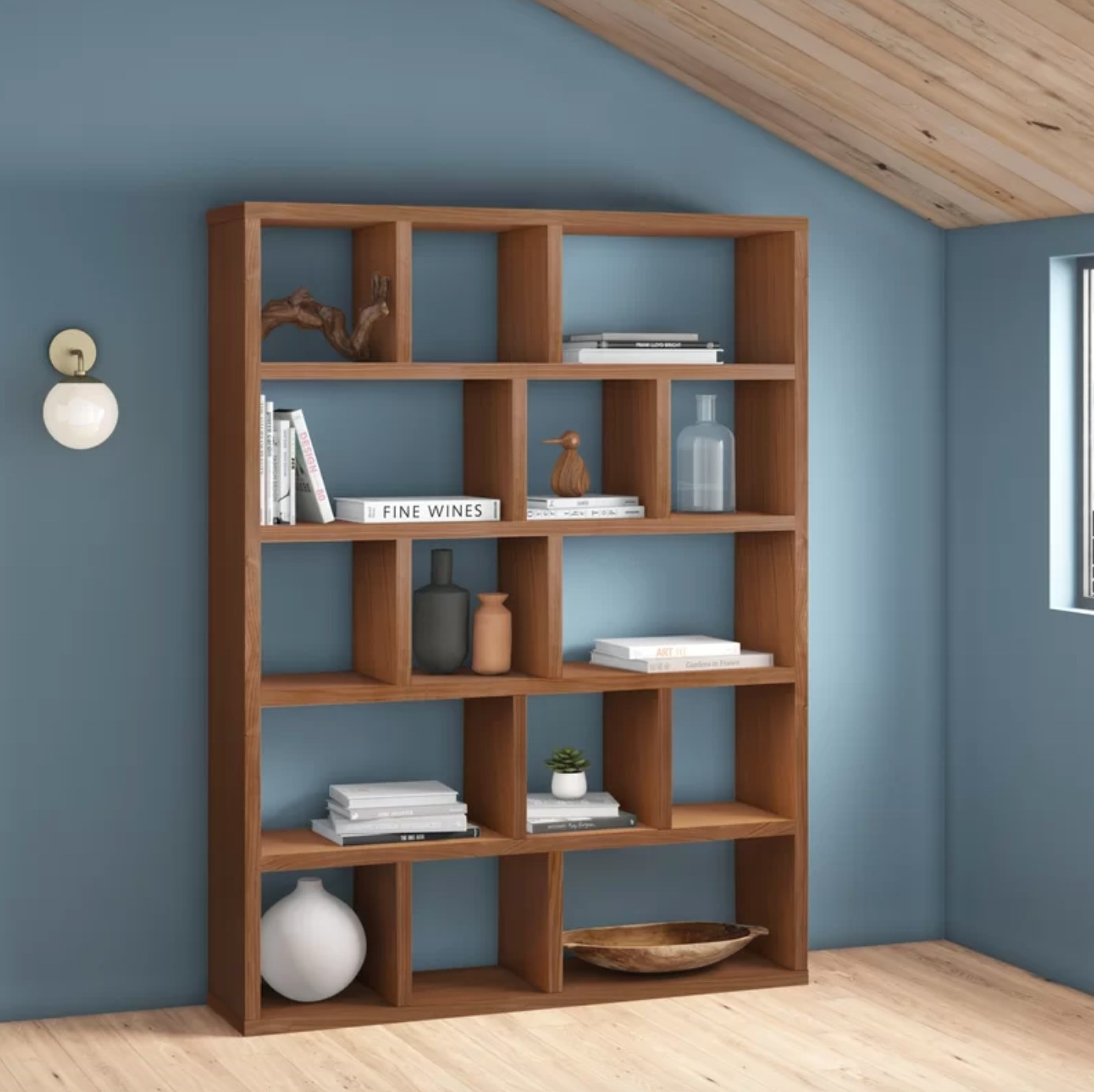 the brown wood bookcase with different size square and rectangular compartments