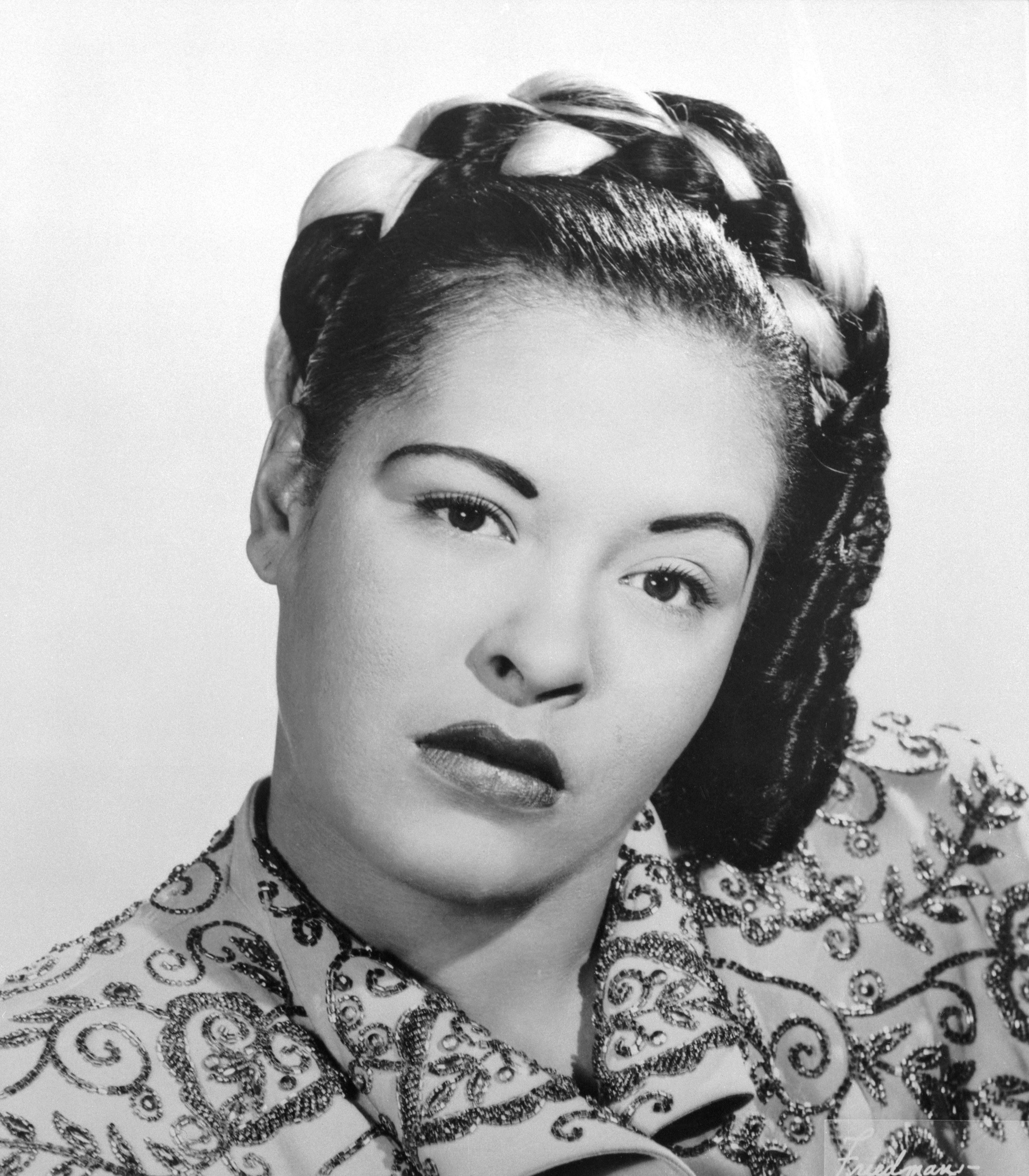 Portrait of Billie Holiday with questioning look and her head tilted