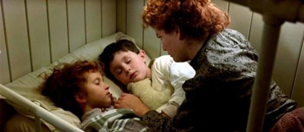 A mother putting her two boys to bed as the ship sinks
