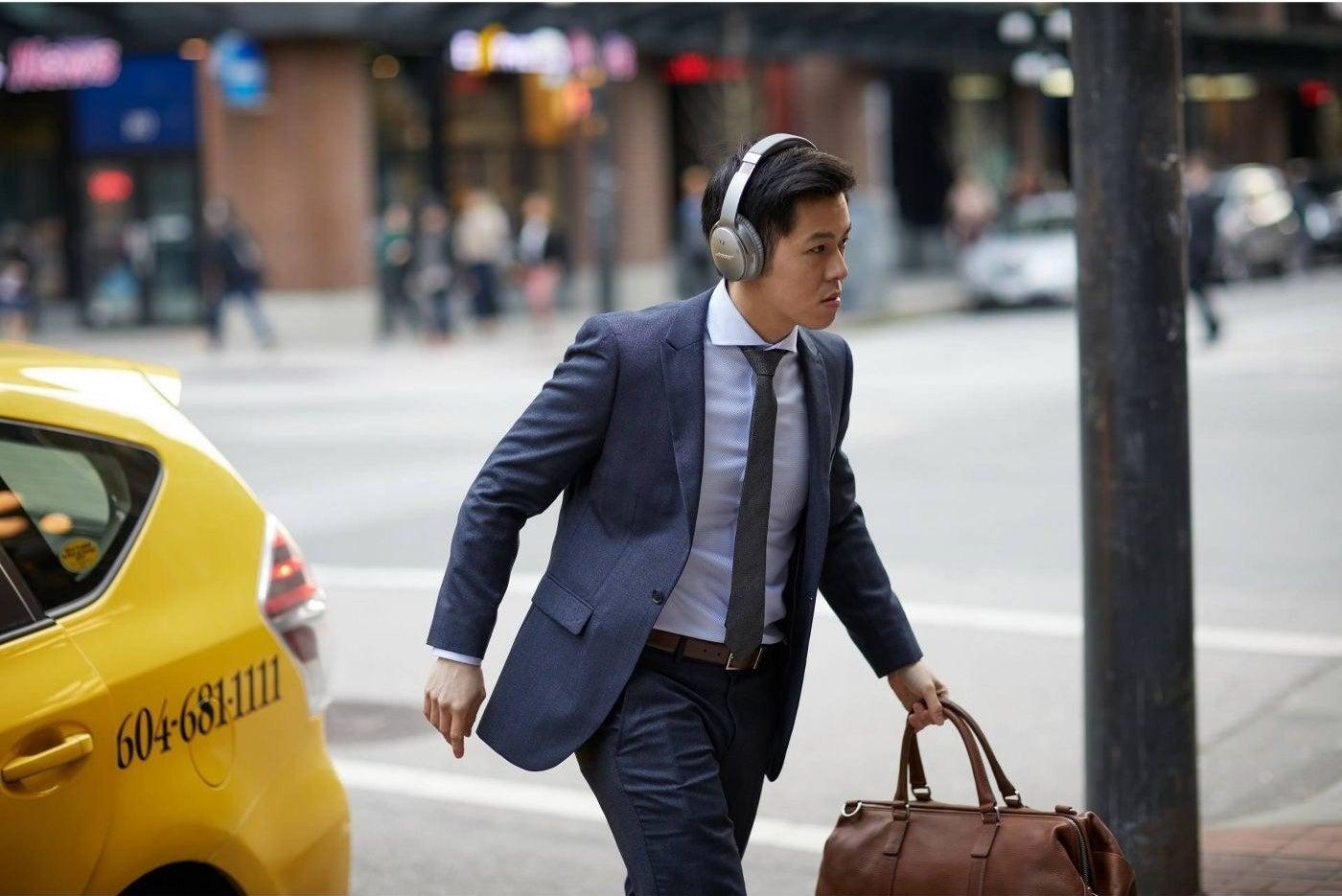 Model wearing noise-canceling headphones