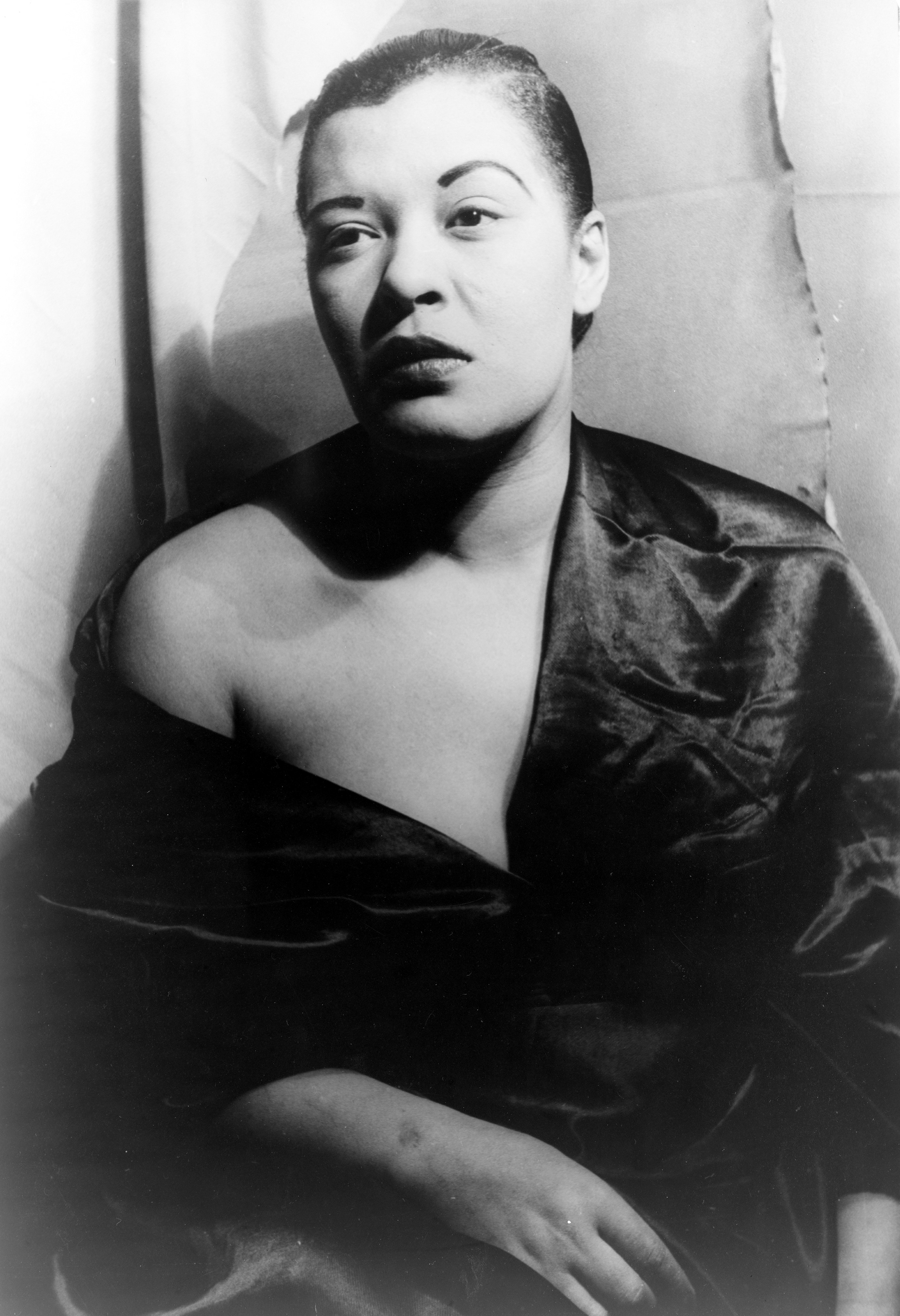 Portrait of Billie Holiday gazing away from the camera