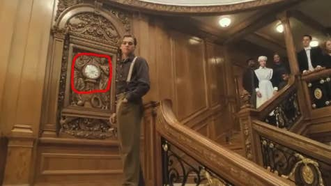Jack standing beside a clock that reads 2:20